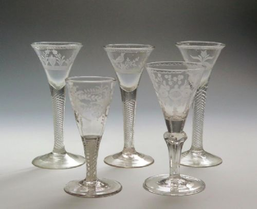 five finely engraved airtwist wine glasses mid 18th century