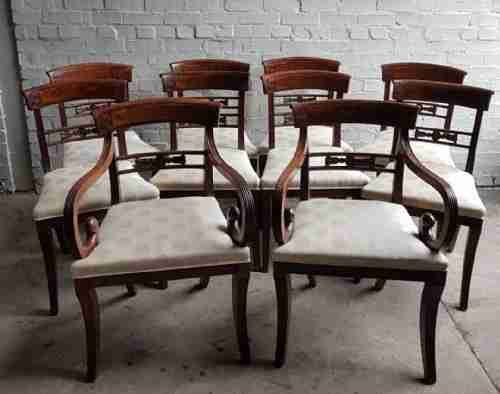 a superb set of 10 regency period mahogany sabre leg chairs incl two carvers