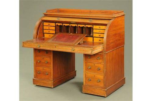a victorian light walnut twin pedestal cylinder desk