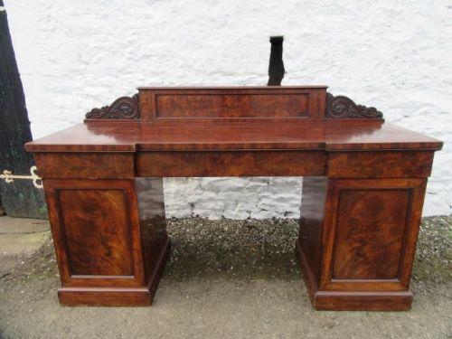 a good large william iv figured mahogany pedestal sideboard