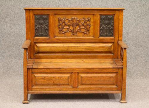 an arts and crafts oak box settle