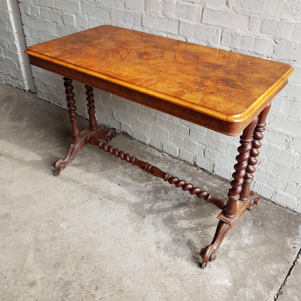 a victorian burr walnut stretcher table