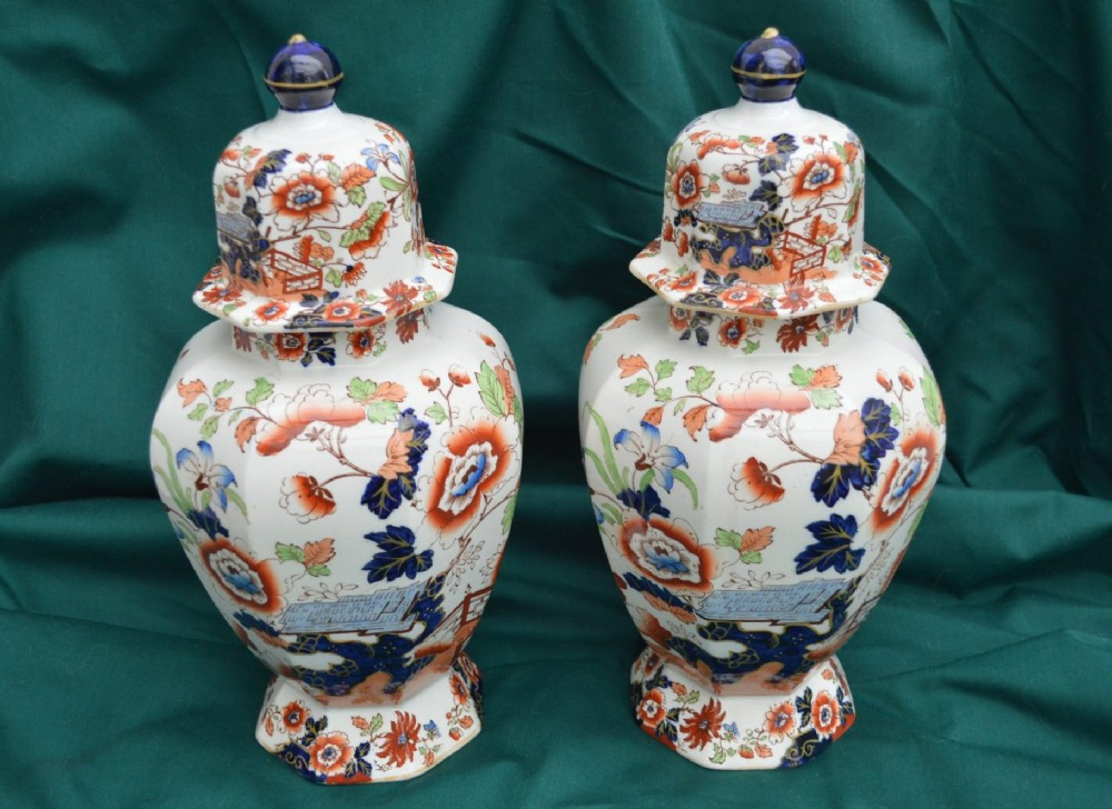 large matching pair of 19th cent masons ironstone lidded urns