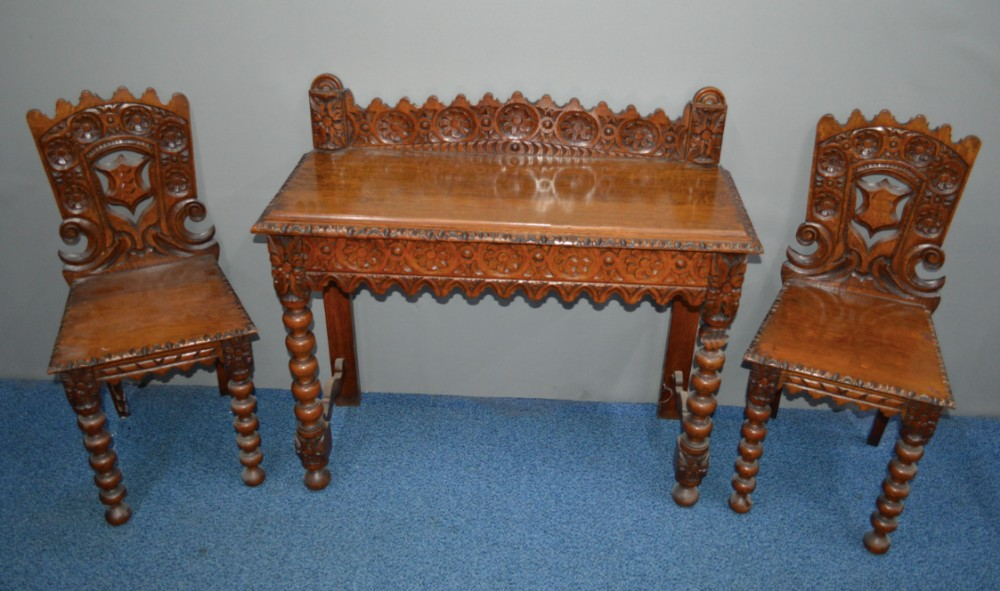 victorian carved oak hall table and matching side chairs