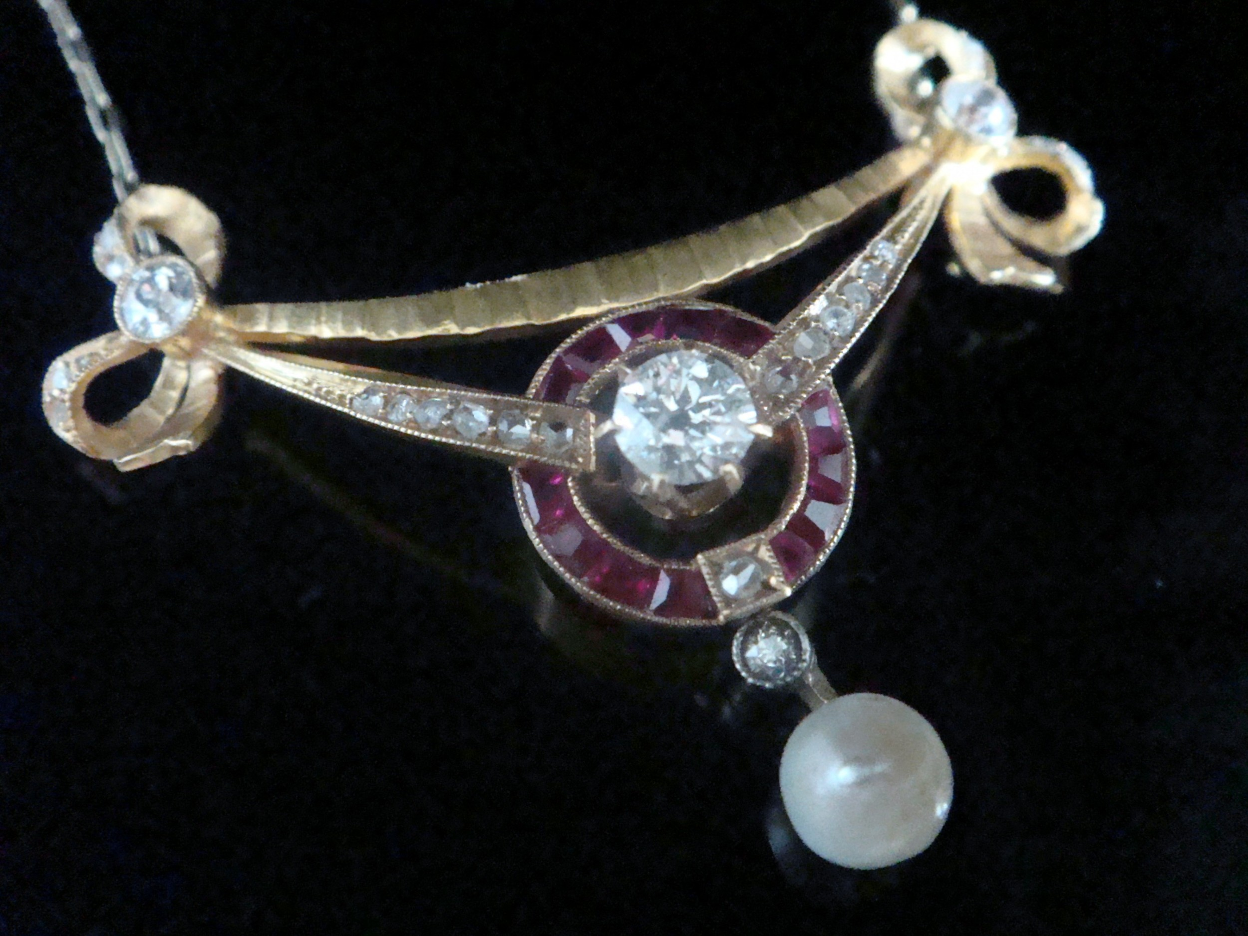 edwardian french 18ct yellow gold calibre cut ruby diamond and natural pearl bow necklace