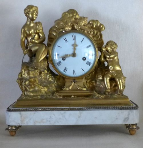 large 19th cent gilt bronze and white marble mantle clock
