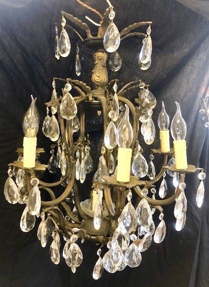 a french dark framed eight light antique chandelier
