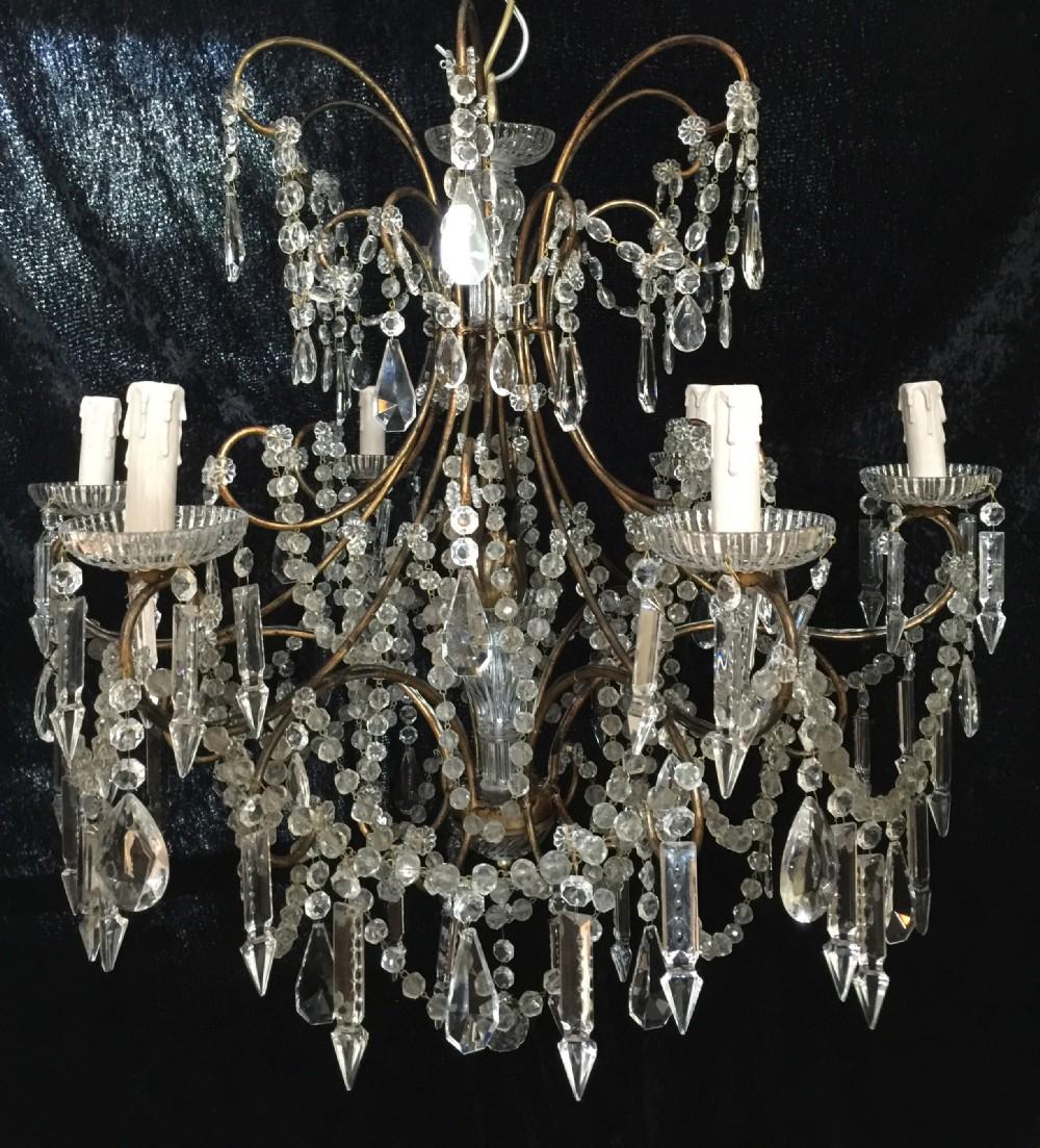 pair of antique florentine chandeliers