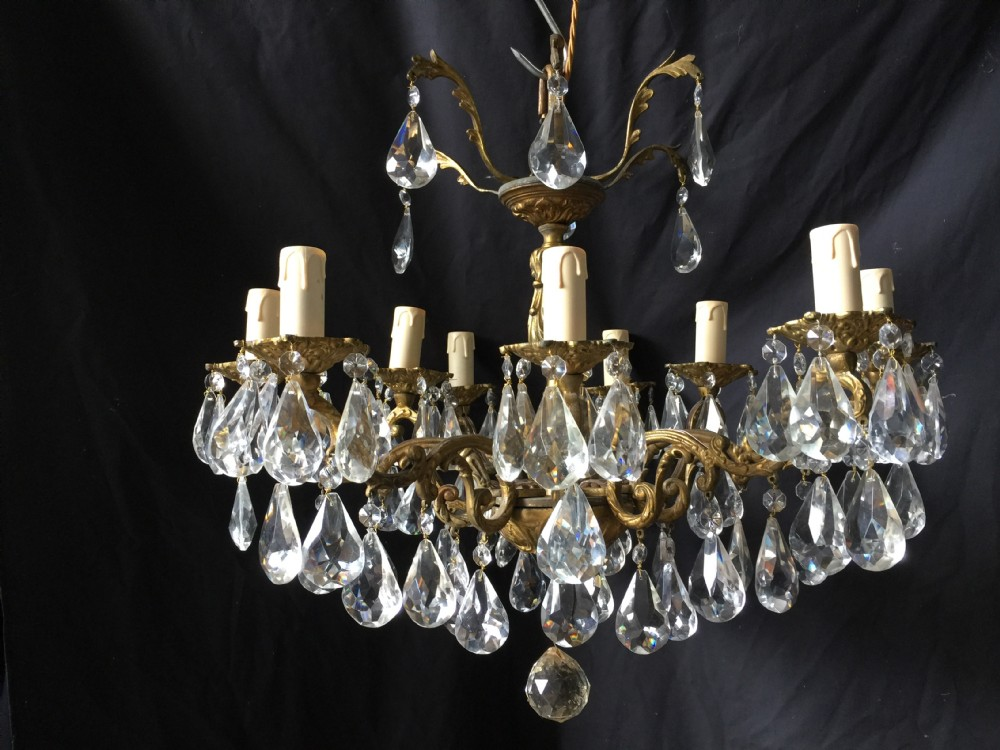 a nine light italian antique brass and crystal chandelier