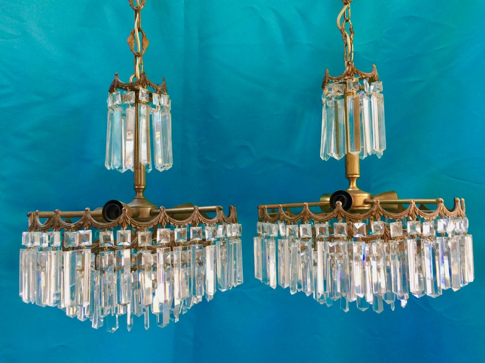 a pair of italian antique three light chandeliers