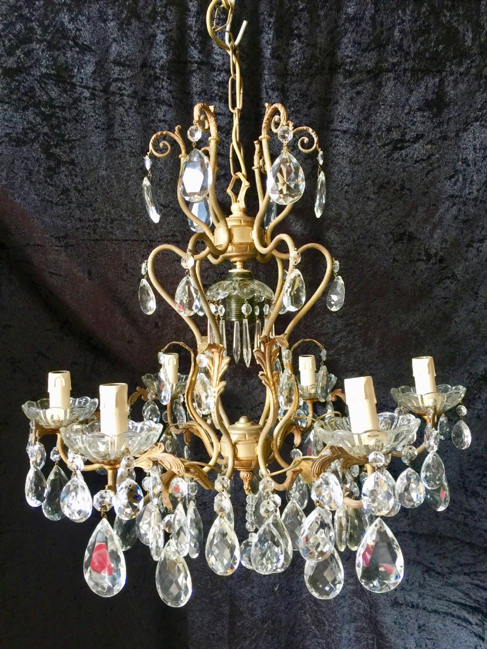 a seven light french brass and crystal antique chandelier
