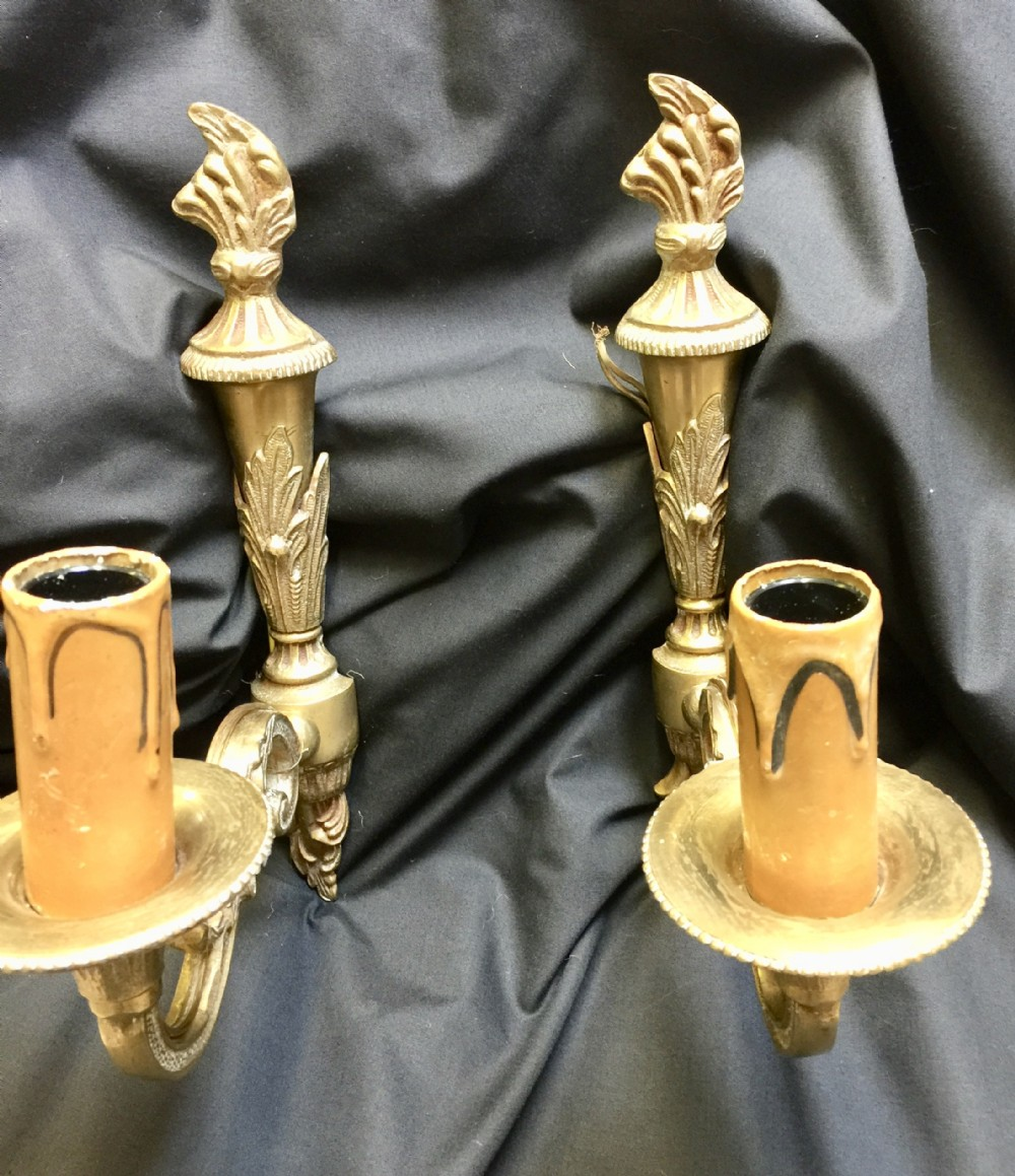 a pair of french single light decorative walllighrts