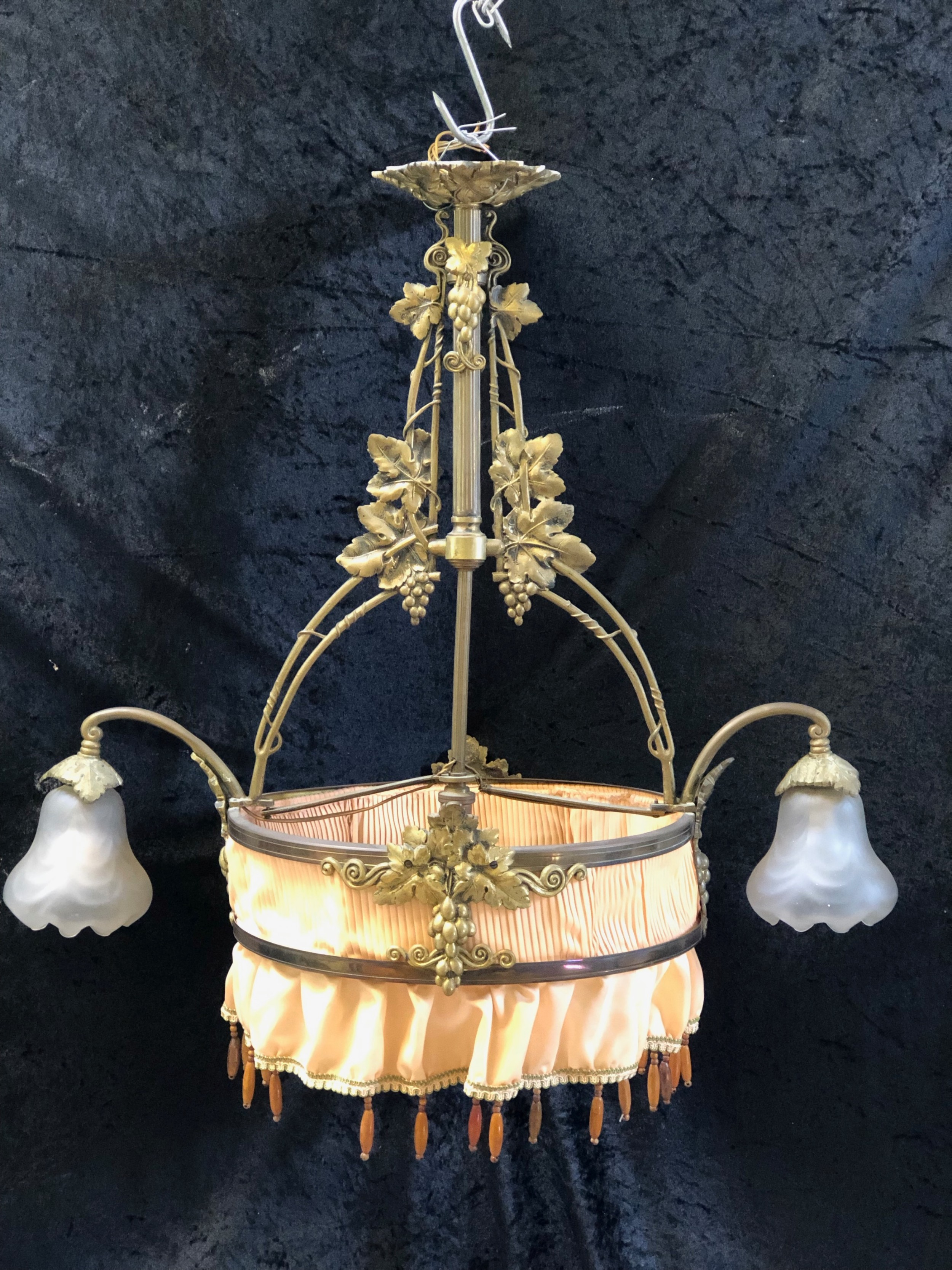 an unusual three light french brass pendant chandelier with skirt