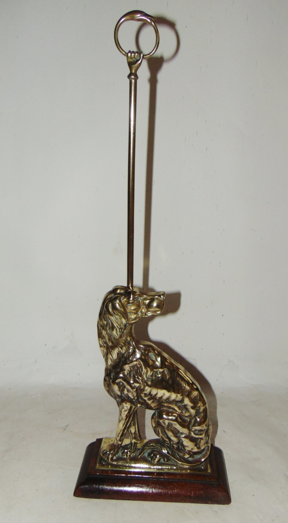 victorian brass door stop as seated dog circa 1850