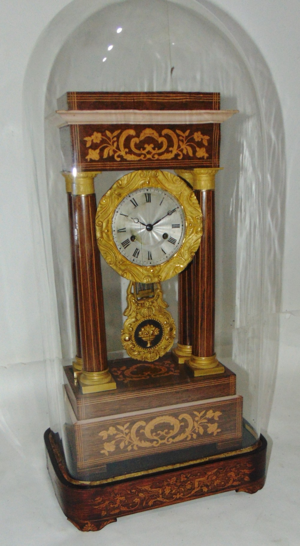 french rosewood portico clock complete with dome stand circa 1830
