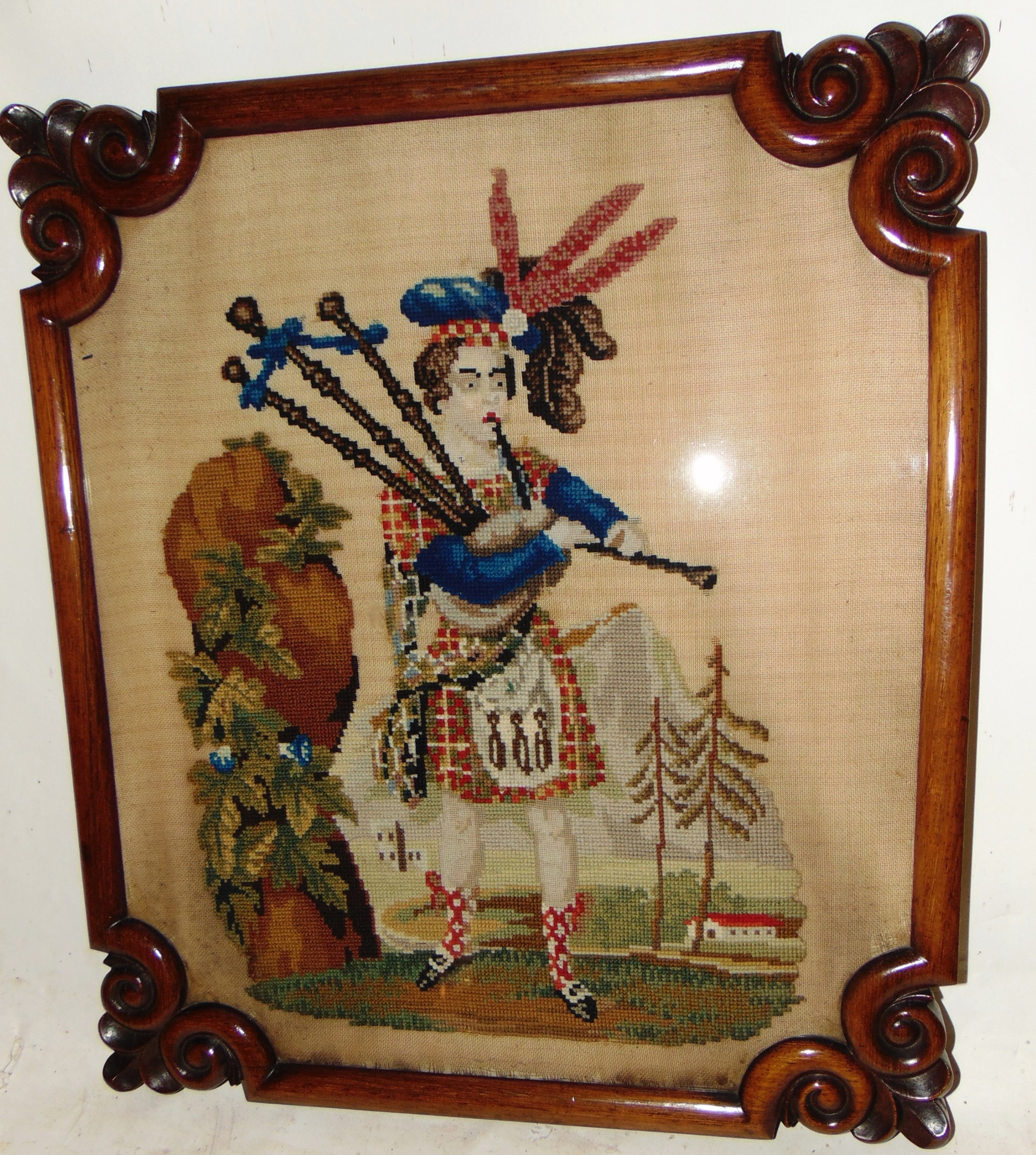 victorian needlework picture of piper circa 1850