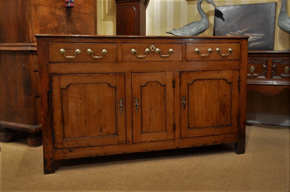a superb 18th century oak cupboard dresser base
