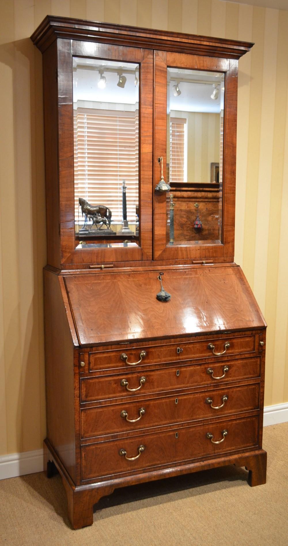 early 18th century walnut mirrored bureau bookcase