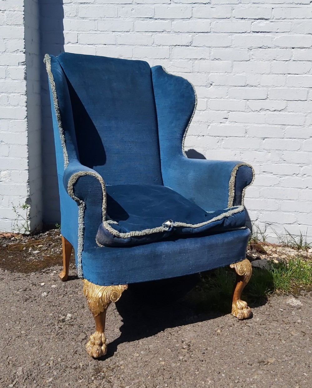 19th century walnut and gilded cabriole leg wing armchair