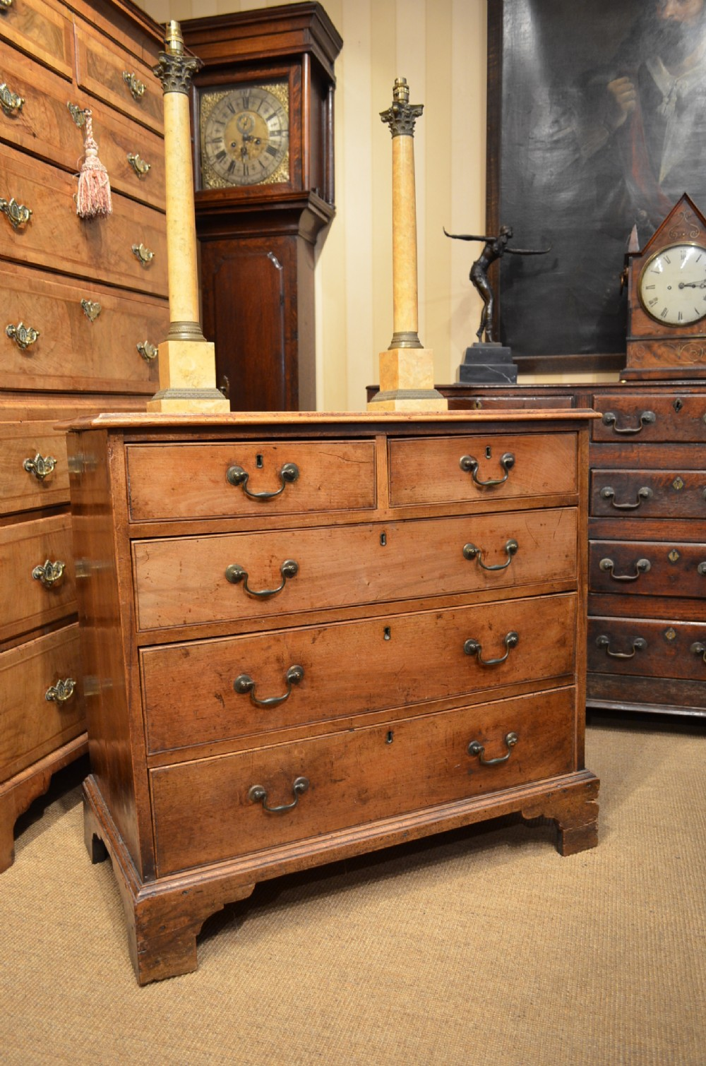 a george ii fruitwood walnut small chest of drawers