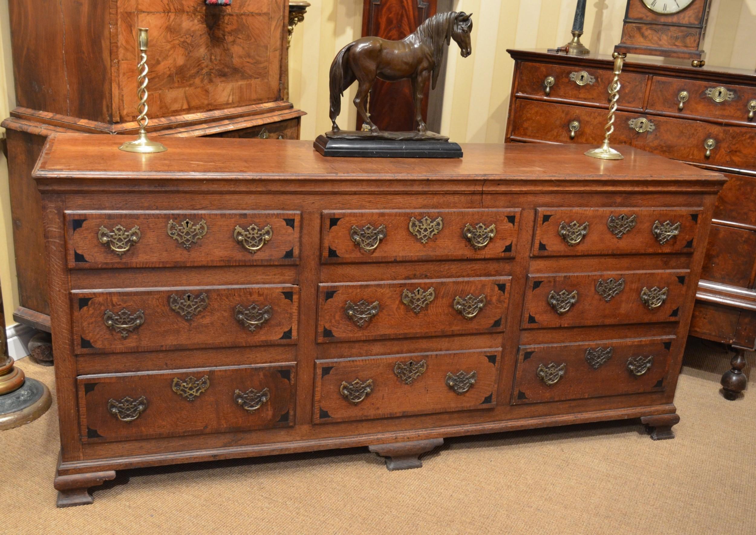 a very impressive oak dresser base with nine drawers