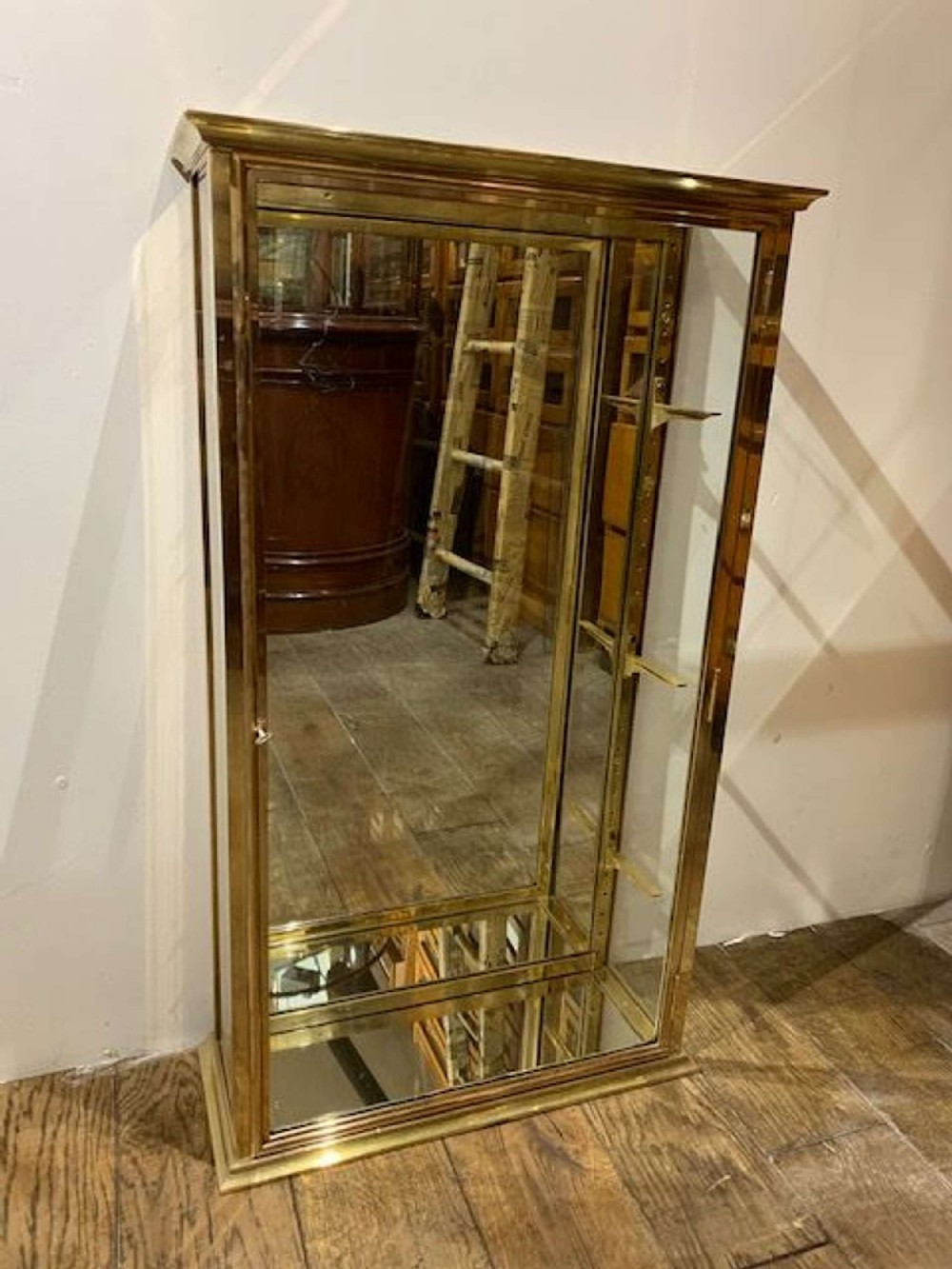 pair of brass 1920s shop display cabinets