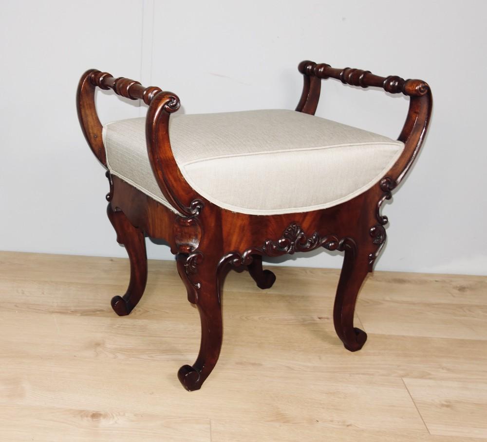 carved mahogany piano stool