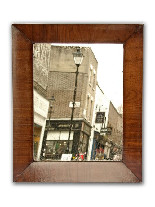 18th century walnut framed mirror with distressed plate