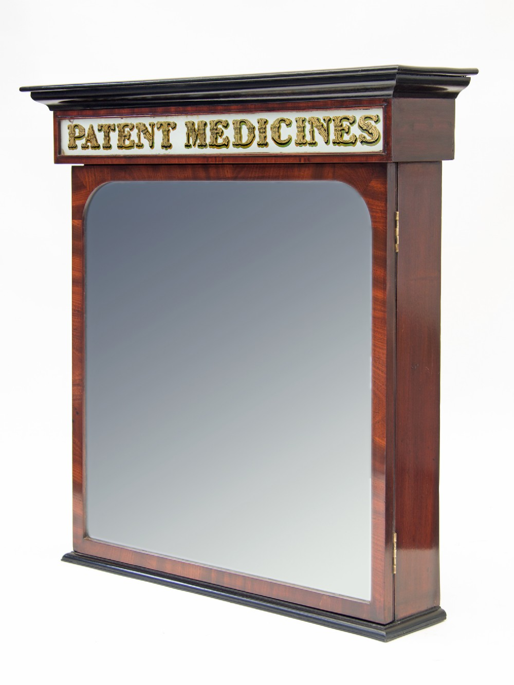 patent medicines pharmacy cabinet with mirrored door