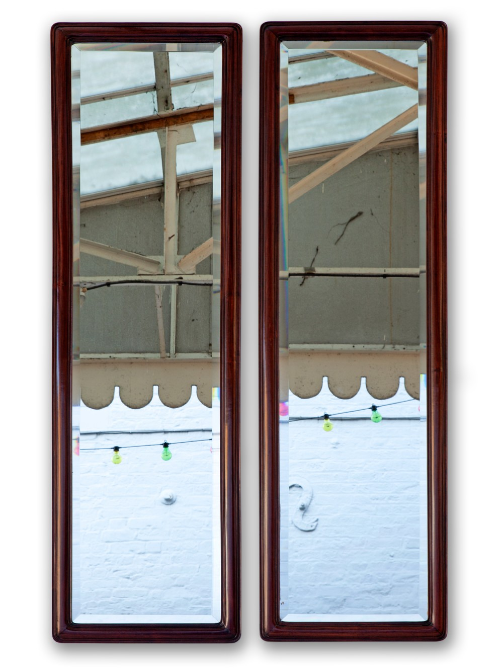 pair of rosewood pier mirrors with original deep beveled plates