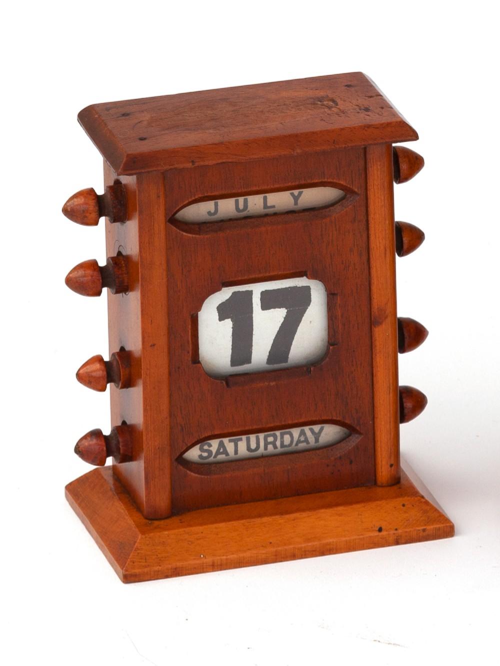 polished mahogany perpetual calendar with bevel edged windows