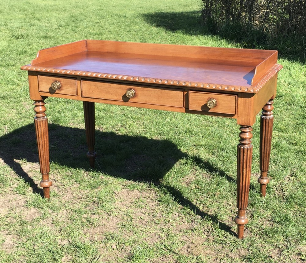 rare 19th century colonial padouk galleried table