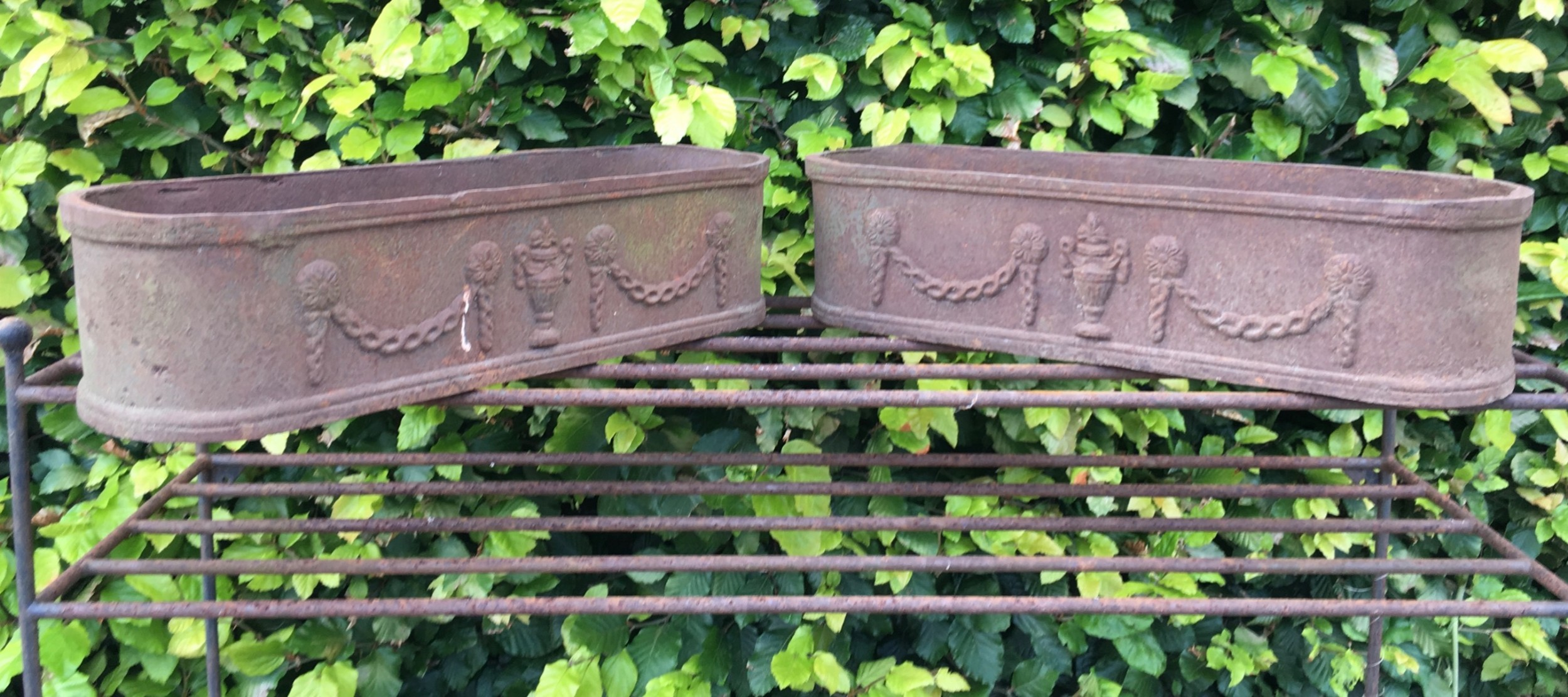 four 19th century cast iron planters