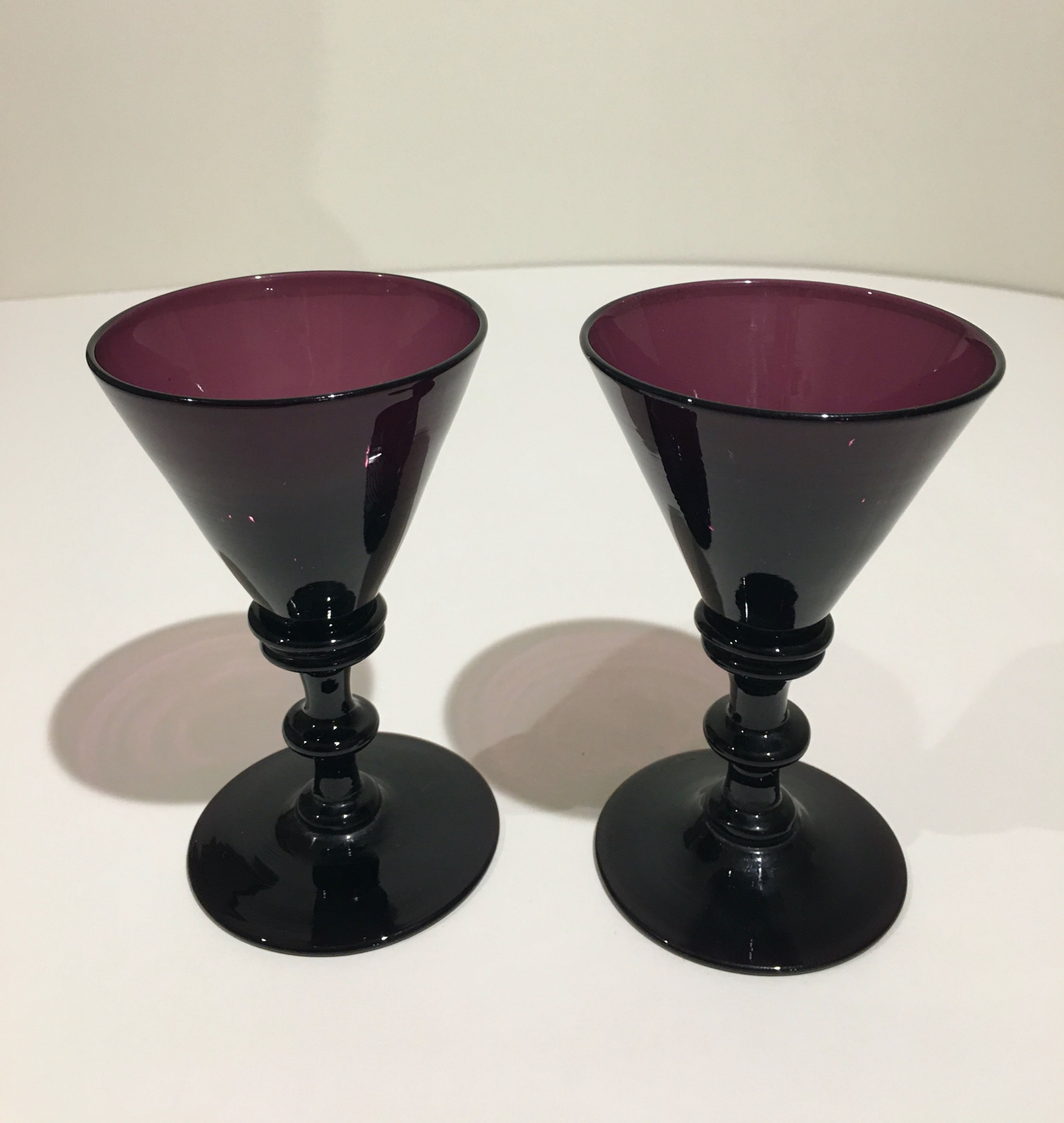 pair of regency period amethyst wine glasses
