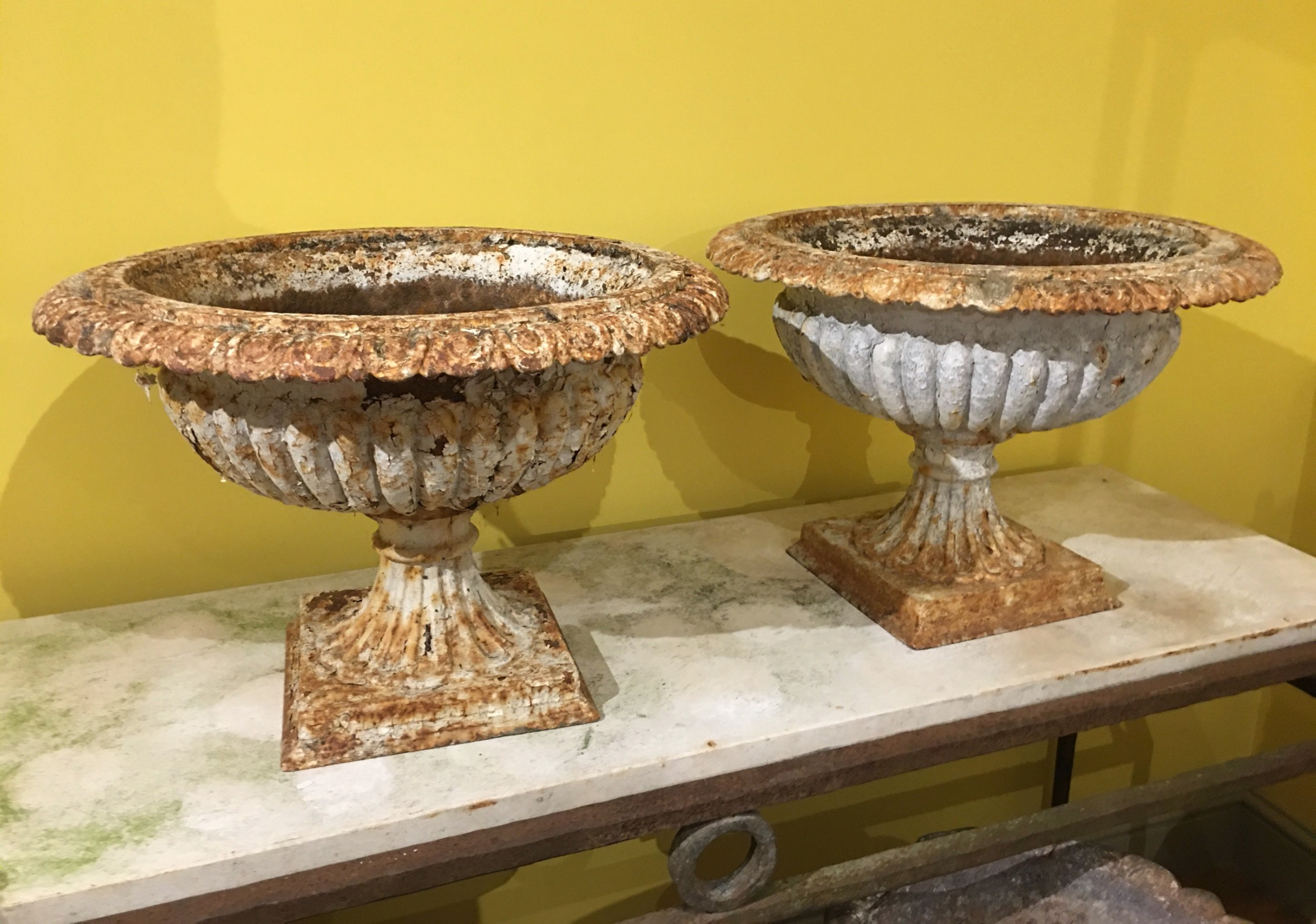 pair of cast iron garden urns