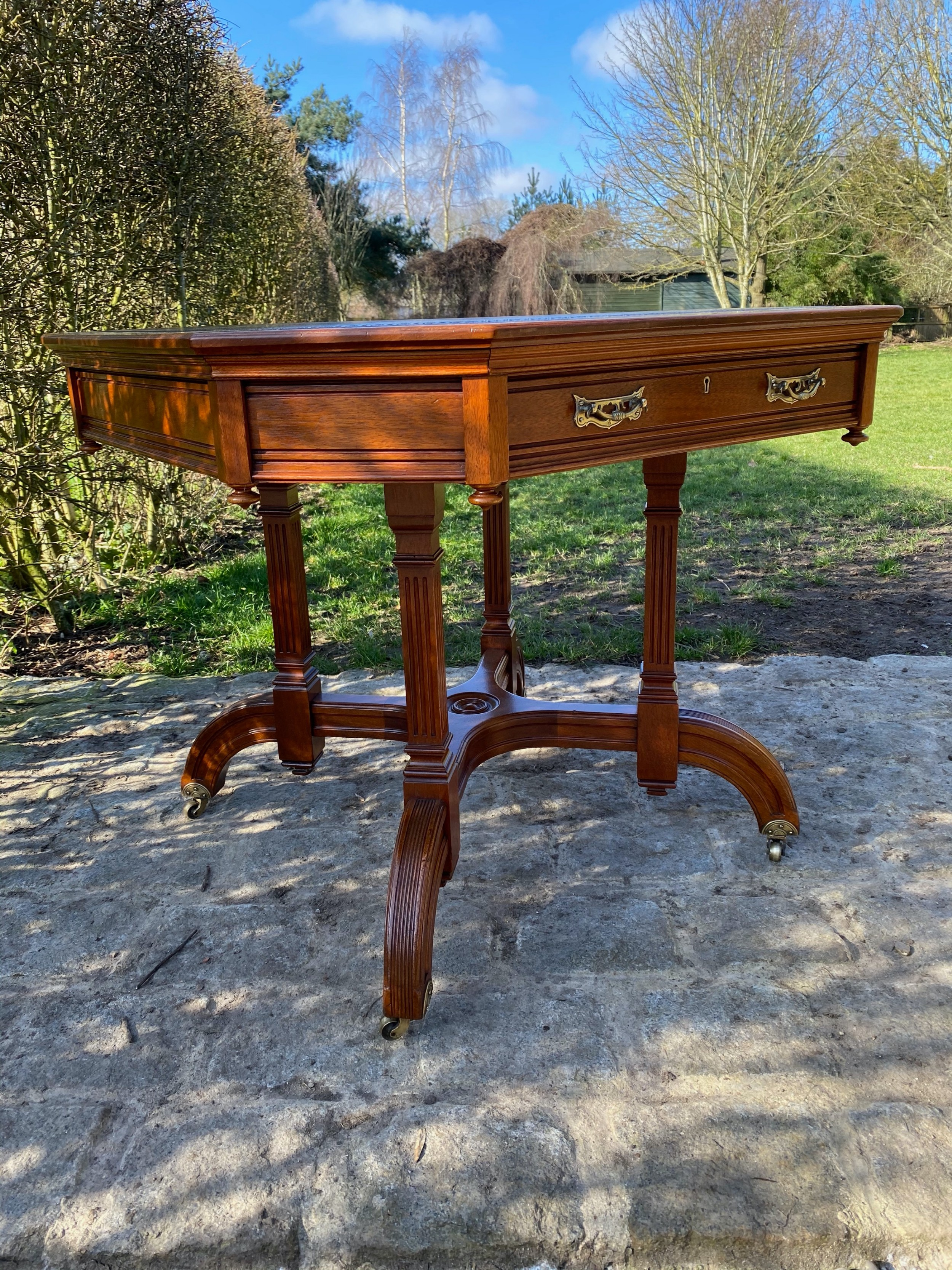 19th century walnut aesthetic movement library drum centre table