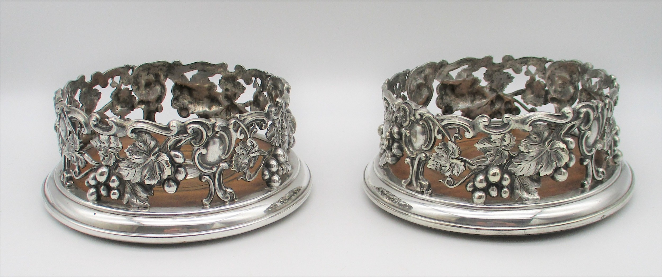stunning pair of silver plated wine bottle coasters by elkington mason c1850