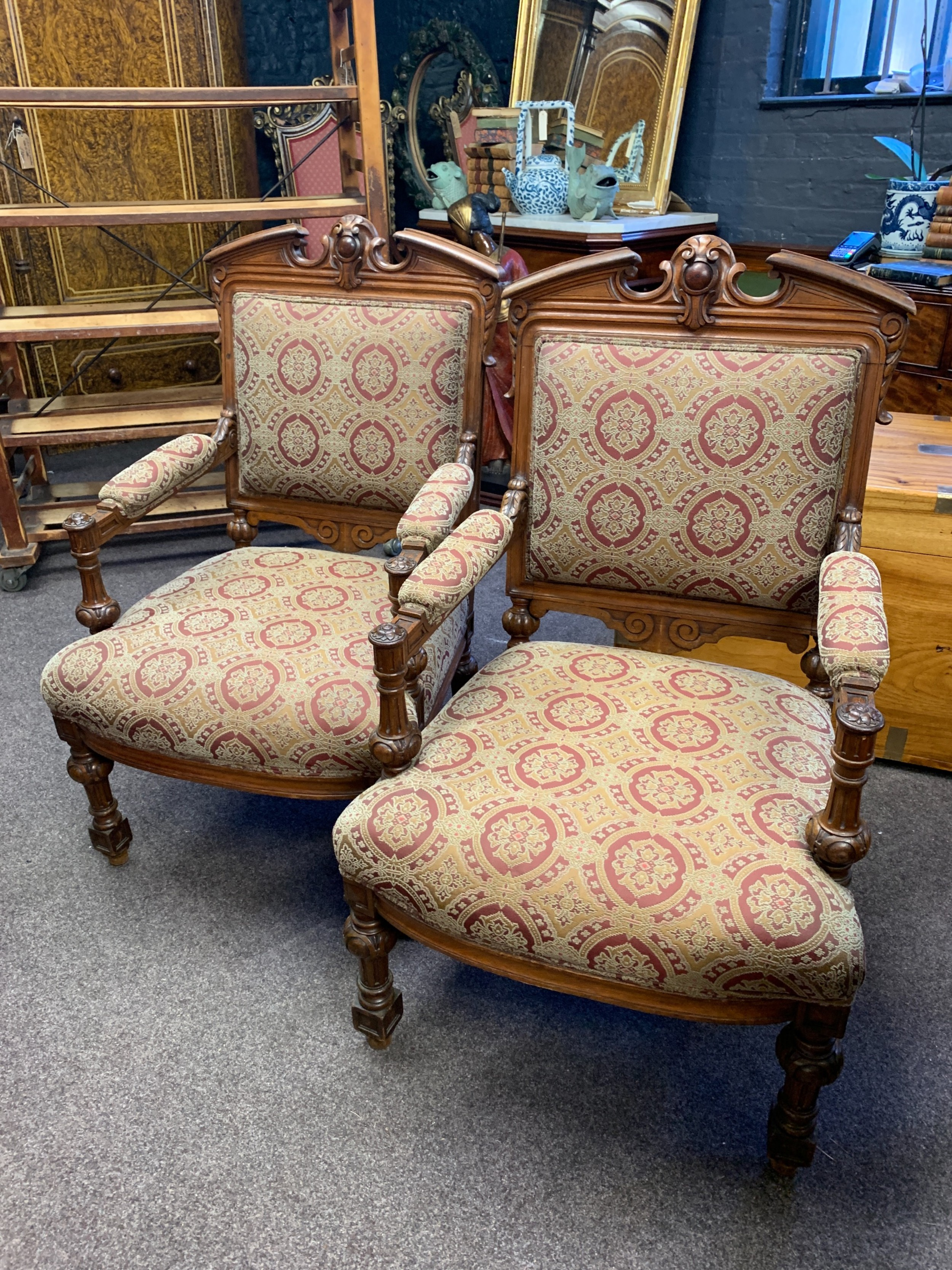 pair of victorian oak framed baronial armchairs
