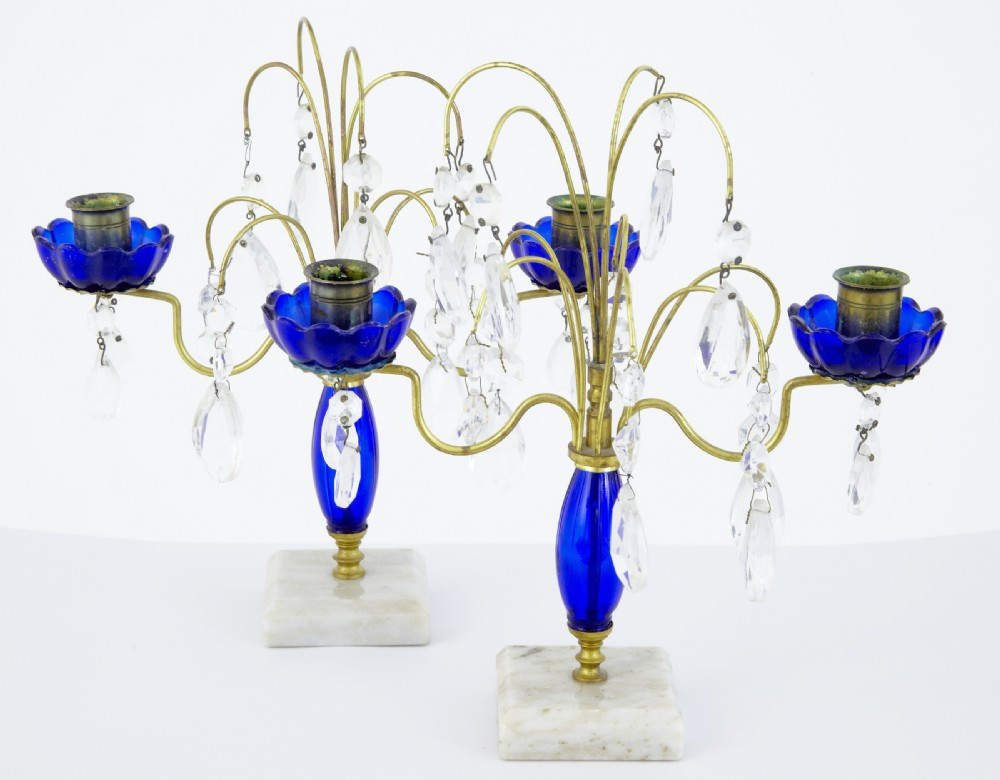 20th century pair of 1930's brass and cut glass decorative candlesticks