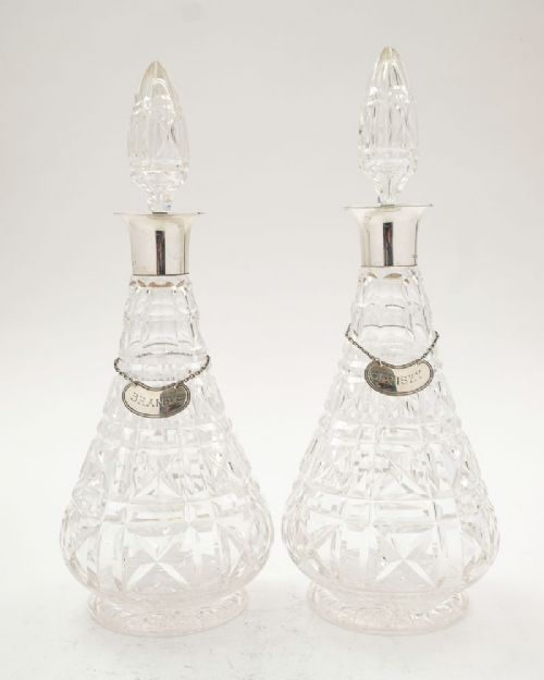 fabulous pair of art deco silver topped decanters london 1930