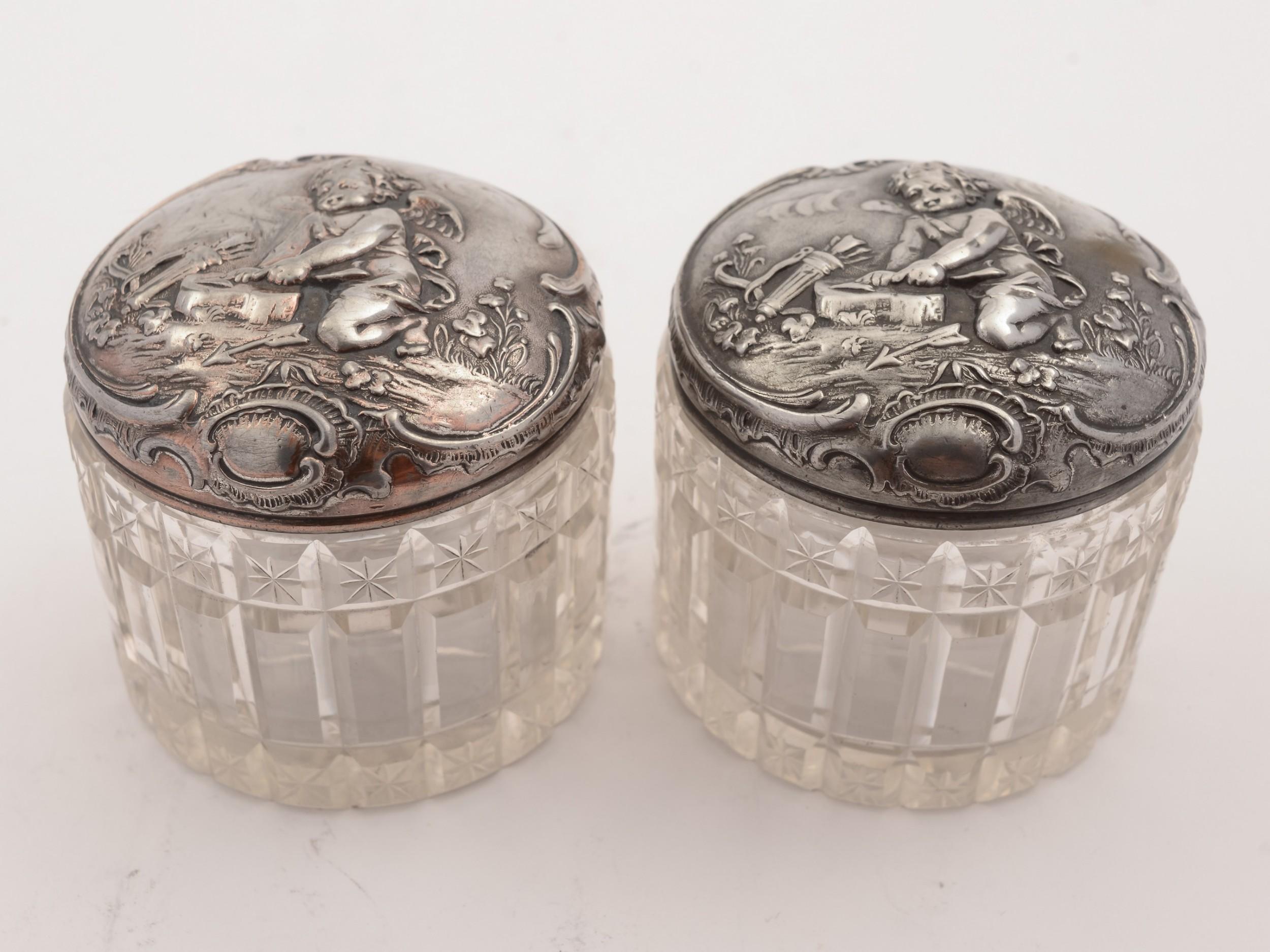 pair of german wmf pewter topped jars circa 1900