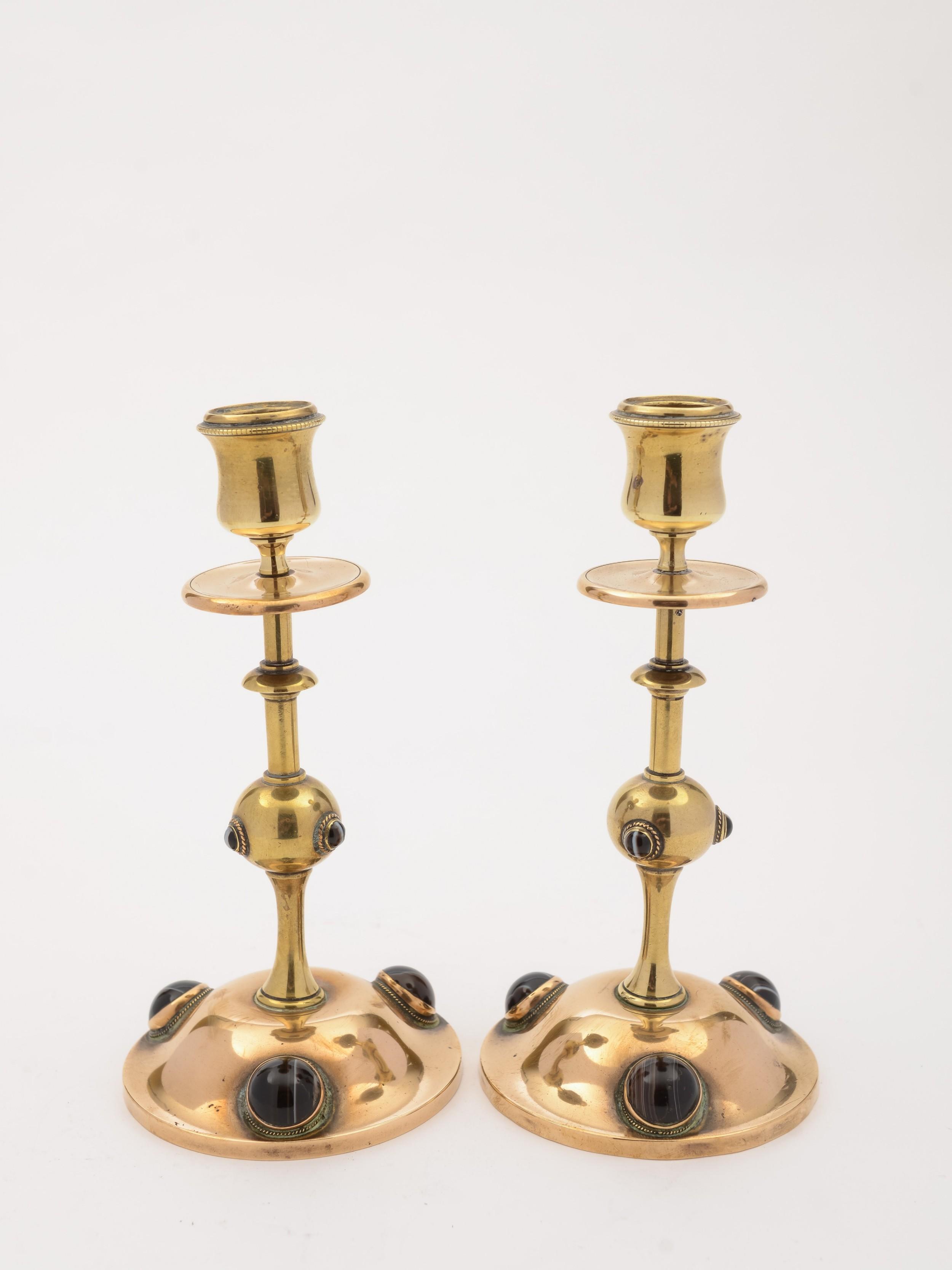 pair of brass arts crafts candlesticks circa 1900