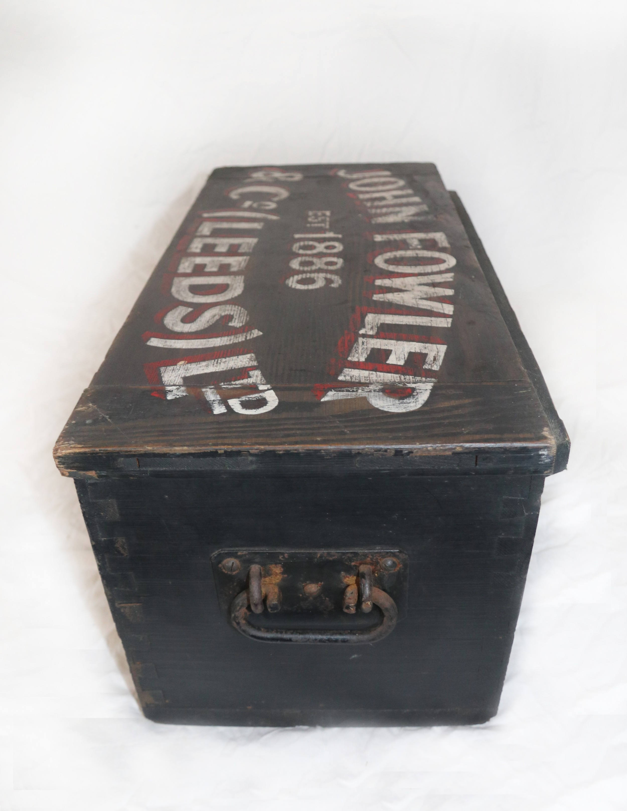 a lovely old wooden trunk which bears later lettering for john fowler and company of leeds