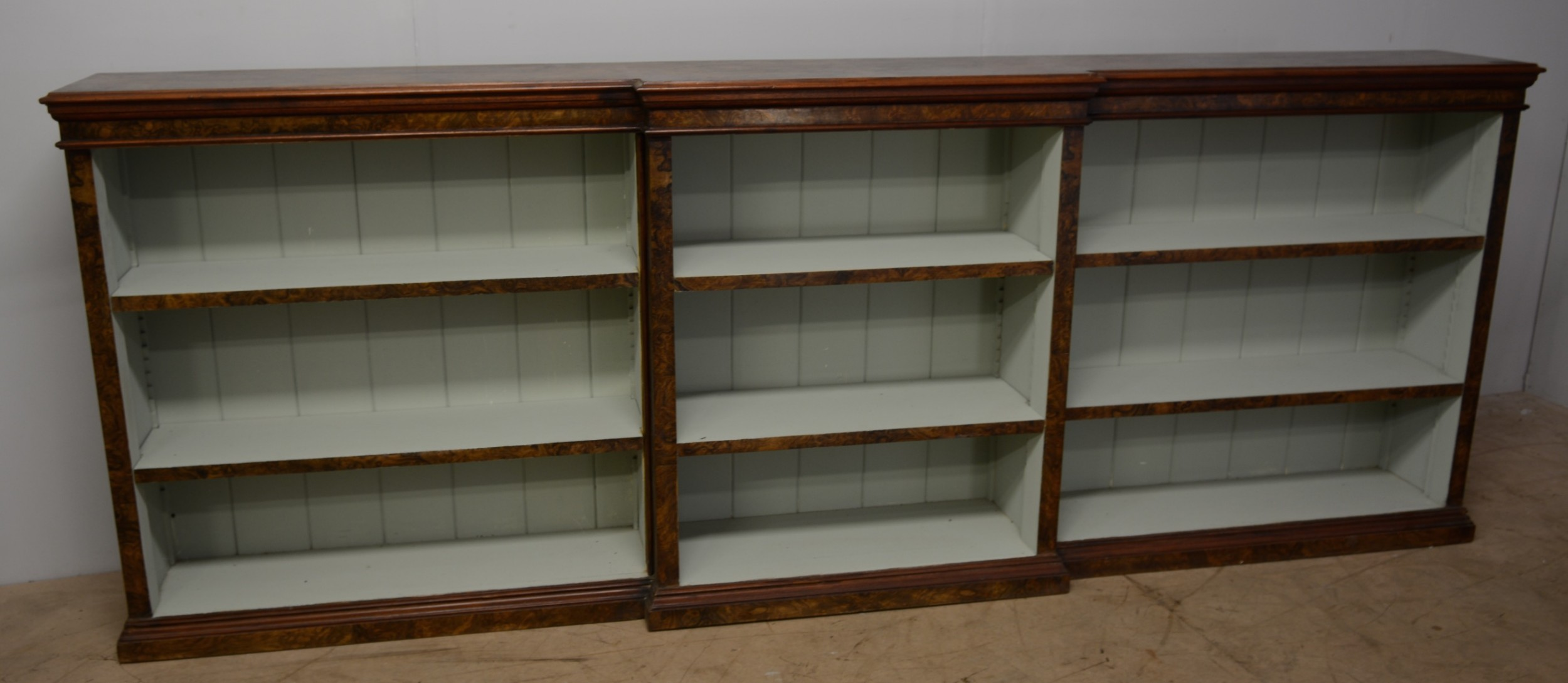 burr walnut open book shelves
