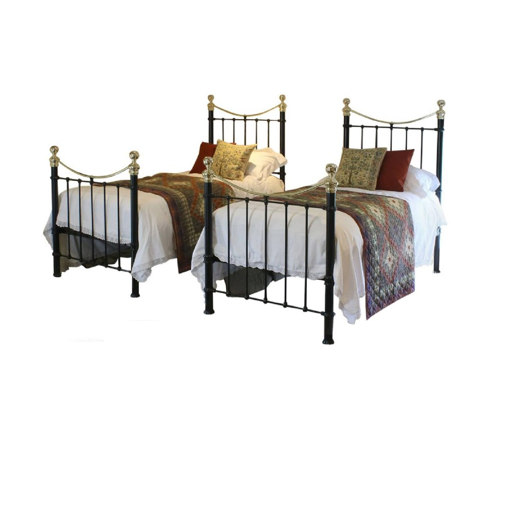 matching pair of twin brass and iron beds