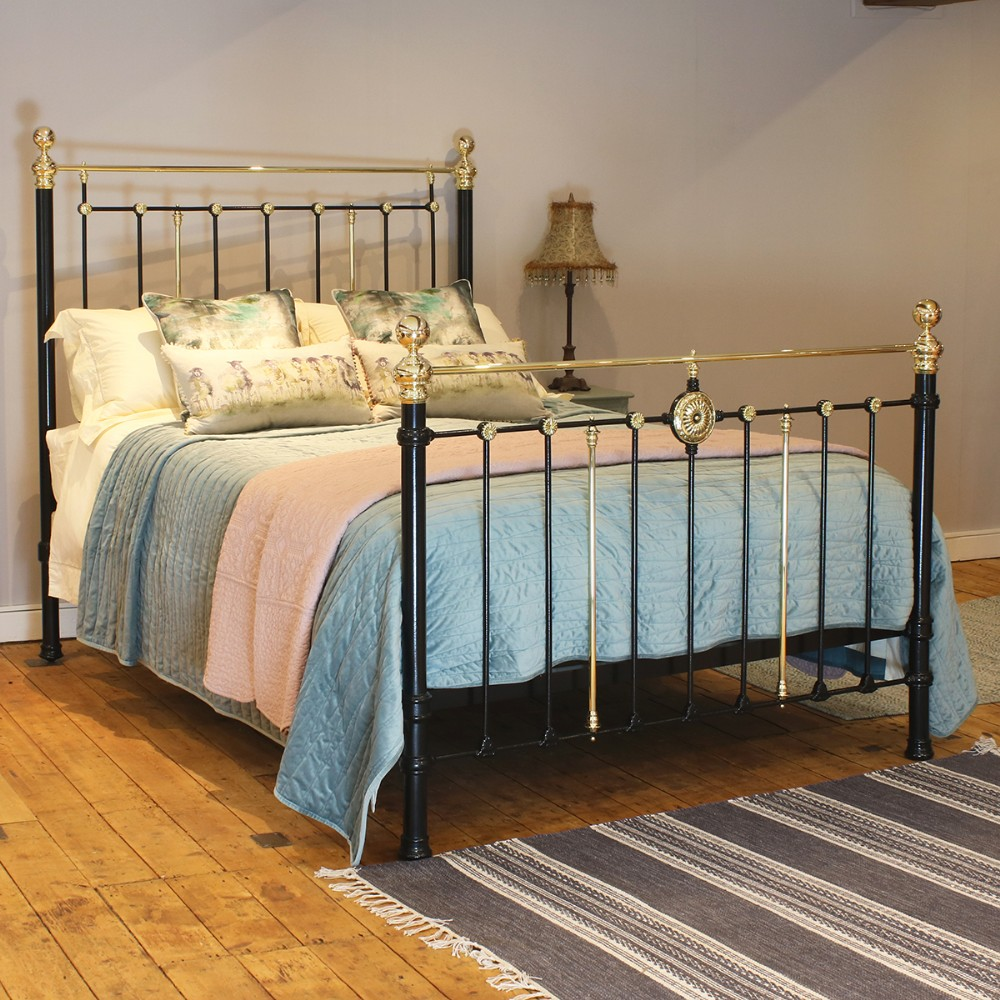 brass and cast iron bed in black