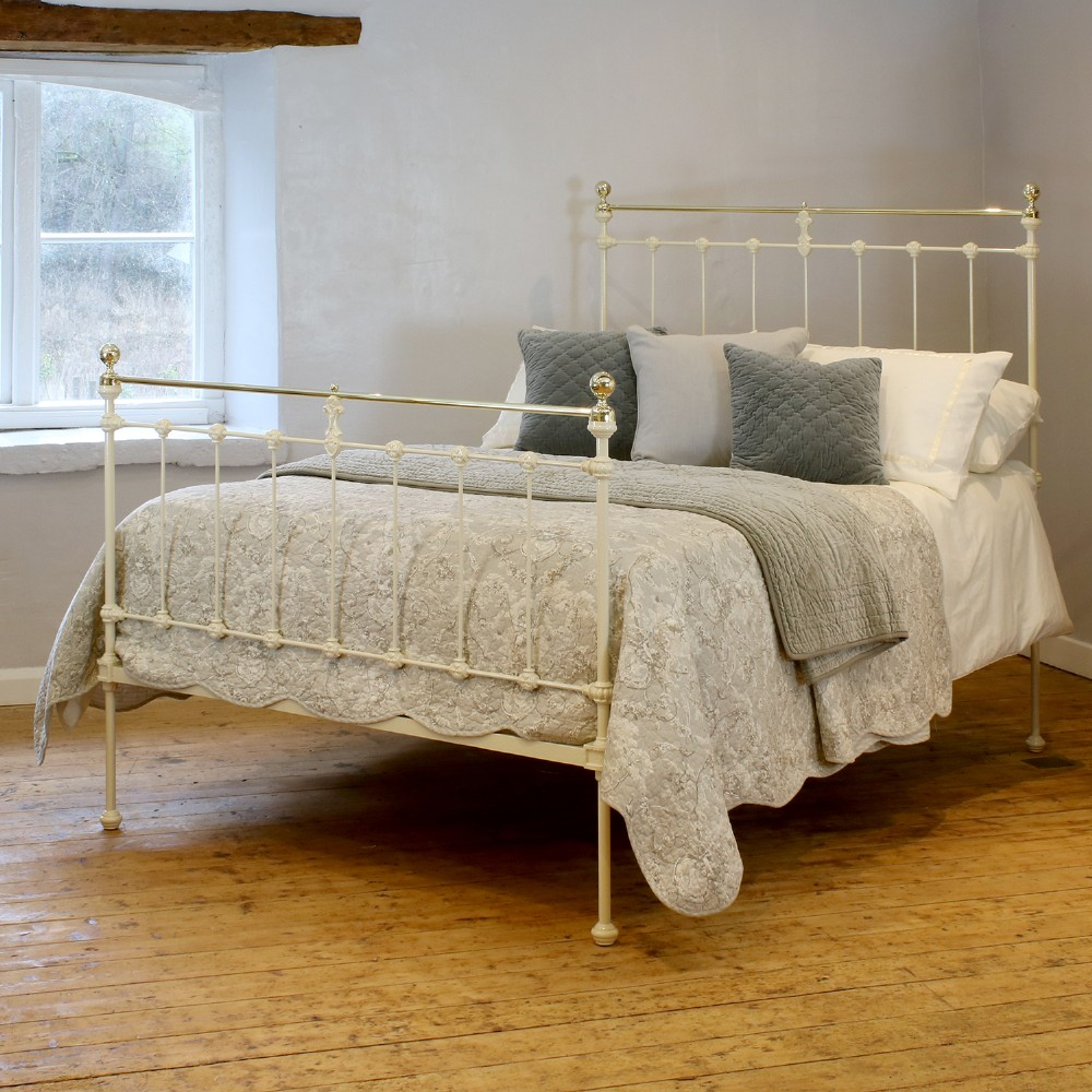 double antique bed in cream