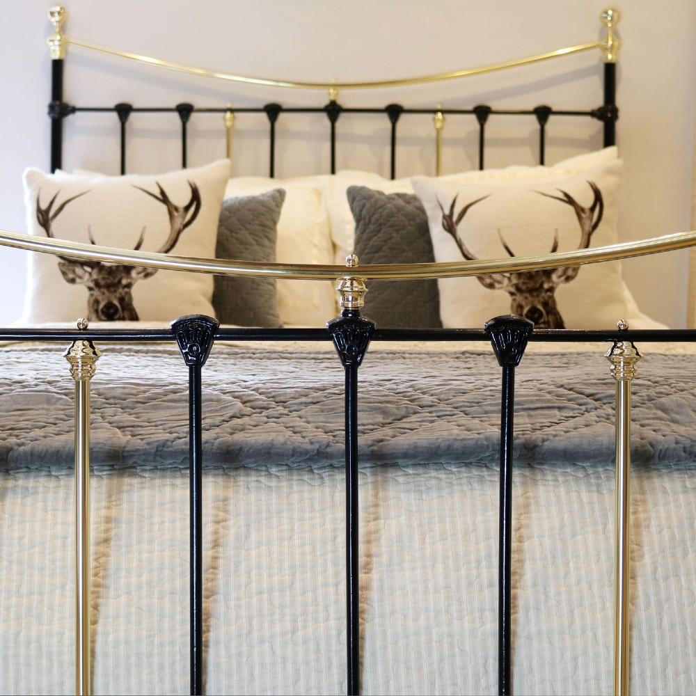 black victorian brass and iron bedstead with brass circles