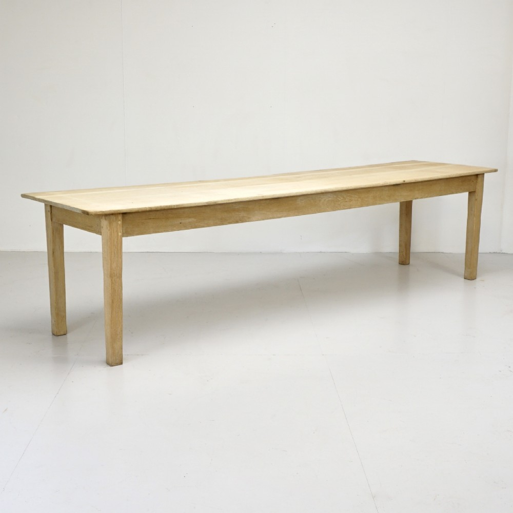 large stripped oak dining table