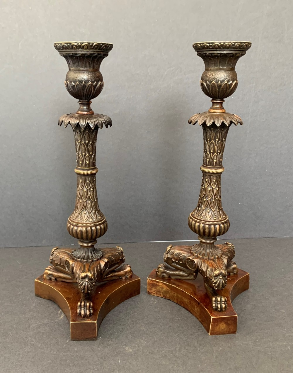 pair of french charles x period bronze candlesticks circa 1830